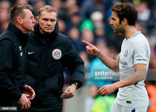 Chelsea's Spanish midfielder Cesc Fabregas gestures to West Ham United's assistant manager Stuart Pearce on the touchline during the English Premier...
