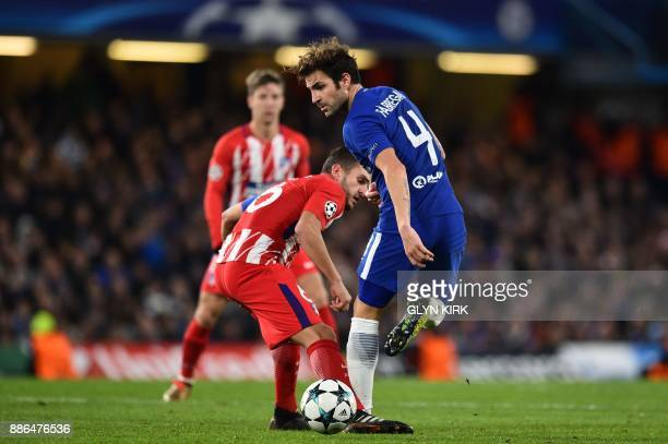 Chelsea's Spanish midfielder Cesc Fabregas plays a back pass during a UEFA Champions League Group C football match between Chelsea and Atletico...