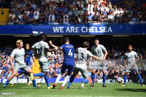 Chelsea's Spanish midfielder Cesc Fabregas scores his team's first goal during the English Premier League football match between Chelsea and Everton...