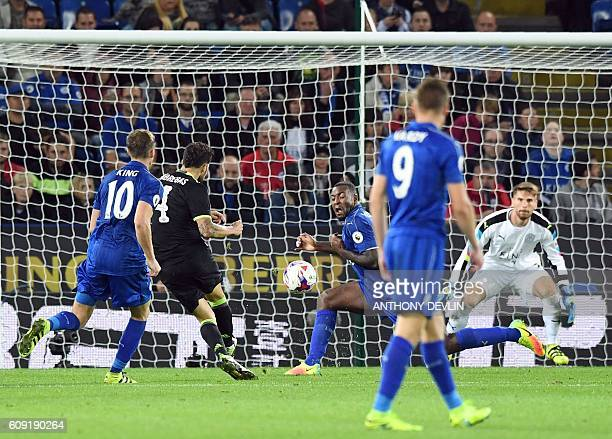 Chelsea's Spanish midfielder Cesc Fabregas shoots to score past Leicester City's Wes Morgan during extratime in the English League Cup third round...