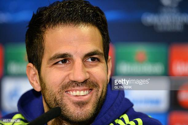 Chelsea's Spanish midfielder Cesc Fabregas smiles during a press conference at Stamford Bridge in London on March 10 ahead of their UEFA Champions...