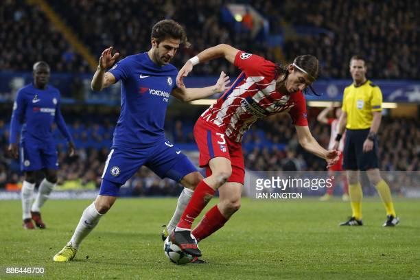 Chelsea's Spanish midfielder Cesc Fabregas tackles Atletico Madrid's Brazilian defender Filipe Luis during a UEFA Champions League Group C football...