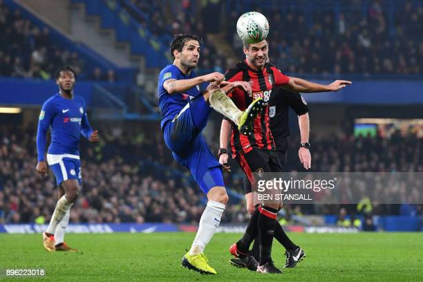 Chelsea's Spanish midfielder Cesc Fabregas vies with Bournemouth's South Africanborn English midfielder Andrew Surman during the English League Cup...