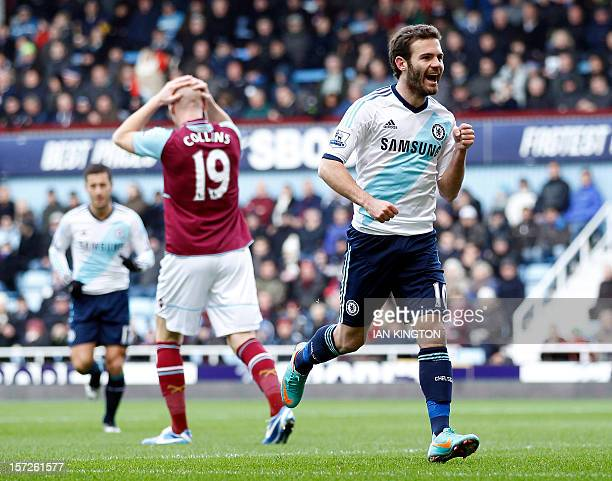 Chelsea's Spanish midfielder Juan Mata celebrates scoring the opening goal as West Ham United's Welsh defender James Collins reacts during the...