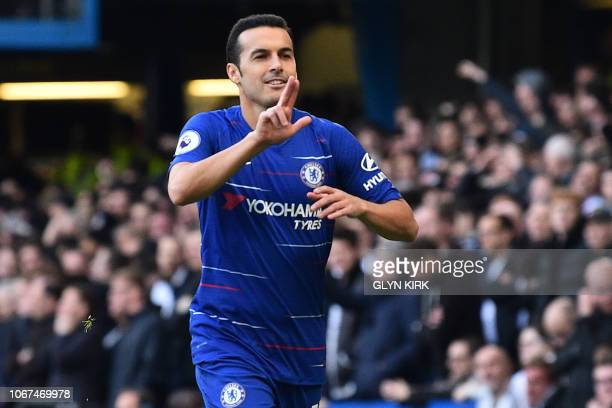 Chelsea's Spanish midfielder Pedro celebrates after scoring the opening goal of the English Premier League football match between Chelsea and Fulham...