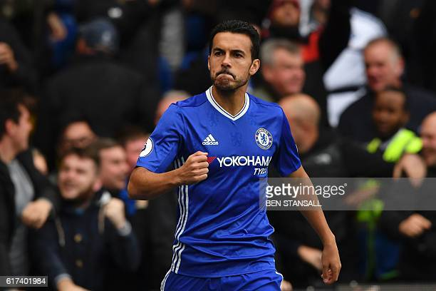 Chelsea's Spanish midfielder Pedro celebrates after scoring the opening goal of the English Premier League football match between Chelsea and...