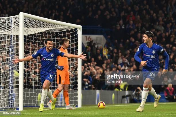 Chelsea's Spanish midfielder Pedro celebrates after scoring their third goal during the English Premier League football match between Chelsea and...
