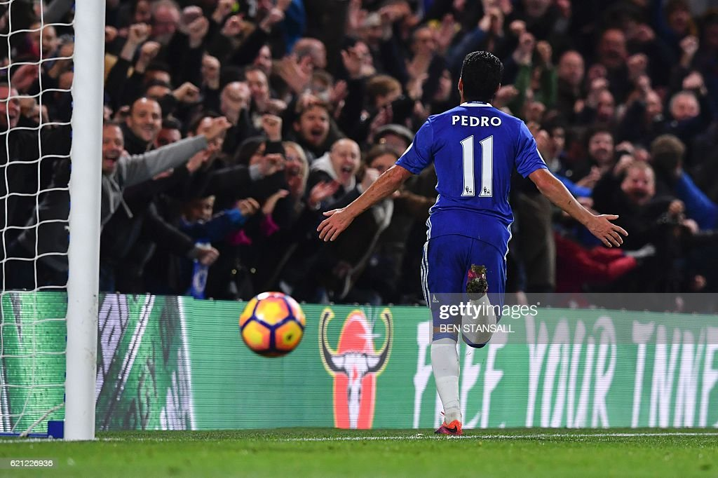 Chelsea's Spanish midfielder Pedro celebrates after scoring their fifth goal during the English Premier League football match between Chelsea and Everton at Stamford Bridge in London on November 5, 2016. / AFP / Ben STANSALL / RESTRICTED TO EDITORIAL USE. No use with unauthorized audio, video, data, fixture lists, club/league logos or 'live' services. Online in-match use limited to 75 images, no video emulation. No use in betting, games or single club/league/player publications. /
