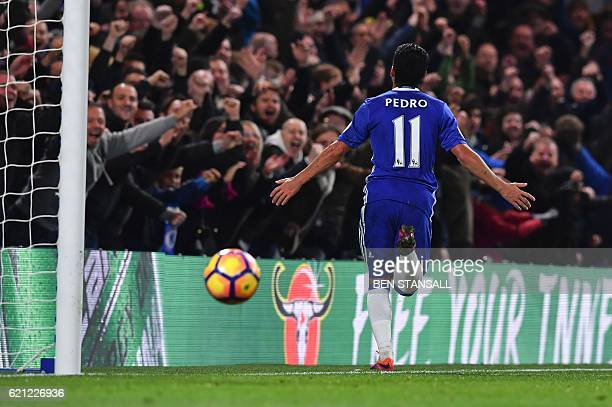 Chelsea's Spanish midfielder Pedro celebrates after scoring their fifth goal during the English Premier League football match between Chelsea and...