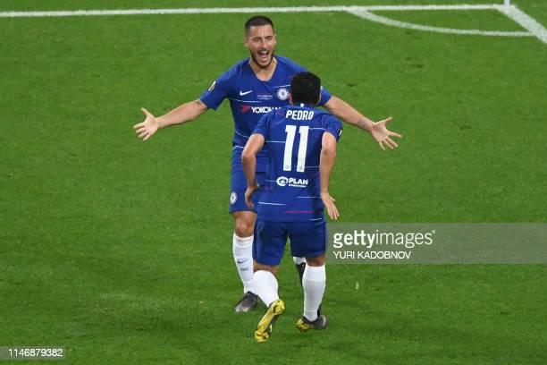 Chelsea's Spanish midfielder Pedro celebrates scoring the 20 goal with his teammate Belgian midfielder Eden Hazard during the UEFA Europa League...