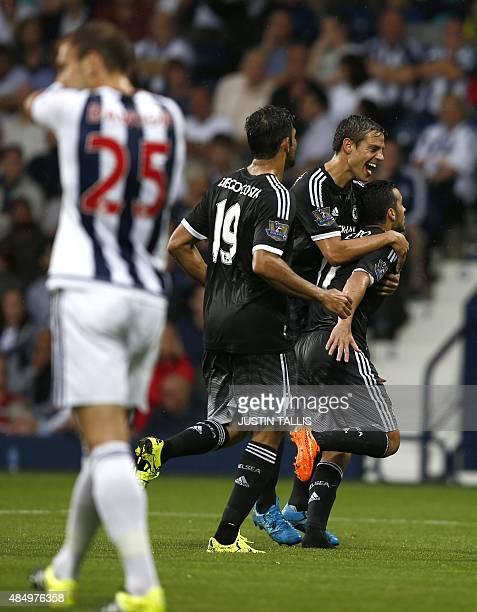 Chelsea's Spanish midfielder Pedro celebrates scoring the opening goal with Chelsea's Spanish defender Cesar Azpilicueta and Chelsea's Brazilianborn...