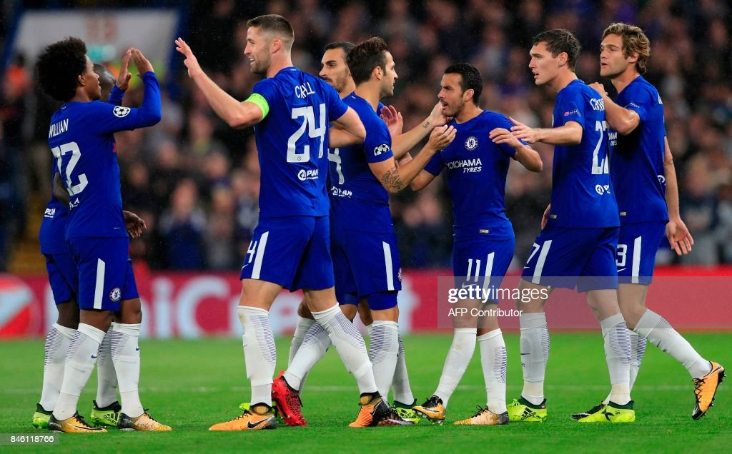 Chelsea's Spanish midfielder Pedro (3R) celebrates scoring the opening goal during the UEFA Champions League Group C football match between Chelsea and Qarabag at Stamford Bridge in London on September 12, 2017. / AFP PHOTO / Adrian DENNIS