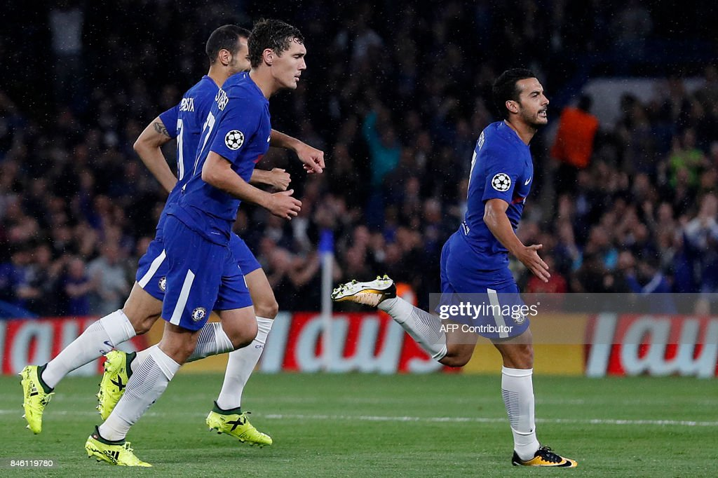 Chelsea's Spanish midfielder Pedro (R) celebrates scoring the opening goal during the UEFA Champions League Group C football match between Chelsea and Qarabag at Stamford Bridge in London on September 12, 2017. / AFP PHOTO / Adrian DENNIS