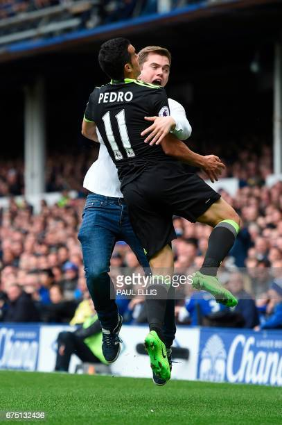 Chelsea's Spanish midfielder Pedro celebrates with a fan after scoring the opening goal during the English Premier League football match between...