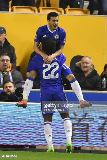 Chelsea's Spanish midfielder Pedro celebrates with Chelsea's Brazilian midfielder Willian after scoring the opening goal of the English FA Cup fifth...
