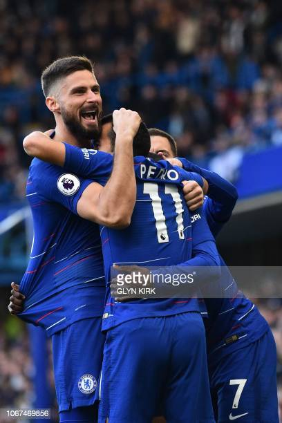 Chelsea's Spanish midfielder Pedro celebrates with Chelsea's French striker Olivier Giroud and teammates after scoring the opening goal of the...