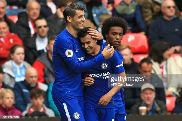 Chelsea's Spanish midfielder Pedro celebrates with Chelsea's Spanish striker Alvaro Morata after scoring their second goal during the English Premier...
