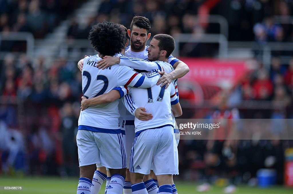Chelsea's Spanish midfielder Pedro (2nd R) celebrates with teammates after scoring the opening goal of the English Premier League football match between Bournemouth and Chelsea at the Vitality Stadium in Bournemouth, southern England on April 23, 2016. / AFP / GLYN KIRK / RESTRICTED TO EDITORIAL USE. No use with unauthorized audio, video, data, fixture lists, club/league logos or 'live' services. Online in-match use limited to 75 images, no video emulation. No use in betting, games or single club/league/player publications. /