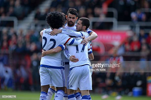 Chelsea's Spanish midfielder Pedro celebrates with teammates after scoring the opening goal of the English Premier League football match between...