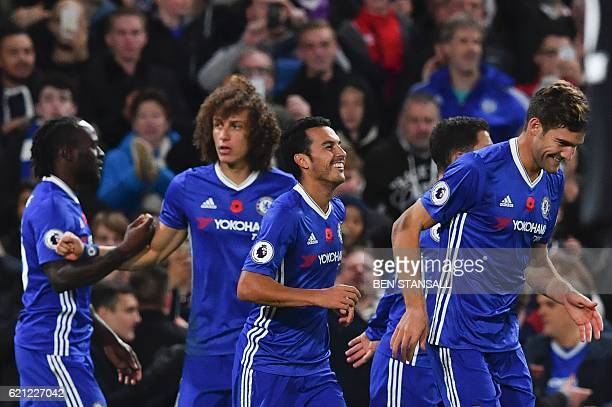 Chelsea's Spanish midfielder Pedro celebrates with teammates after scoring their fifth goal during the English Premier League football match between...