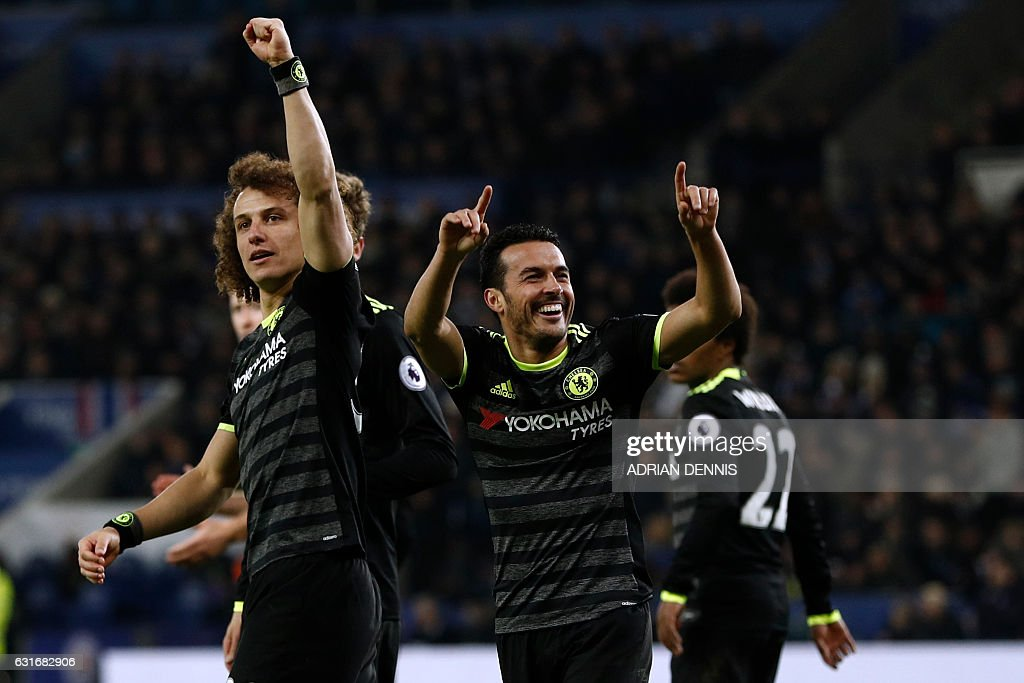 Chelsea's Spanish midfielder Pedro (2nd R) celebrates with teammates after scoring their third goal during the English Premier League football match between Leicester City and Chelsea at King Power Stadium in Leicester, central England on January 14, 2017. Cheslea won the game 3-0. / AFP / Adrian DENNIS / RESTRICTED TO EDITORIAL USE. No use with unauthorized audio, video, data, fixture lists, club/league logos or 'live' services. Online in-match use limited to 75 images, no video emulation. No use in betting, games or single club/league/player publications. /