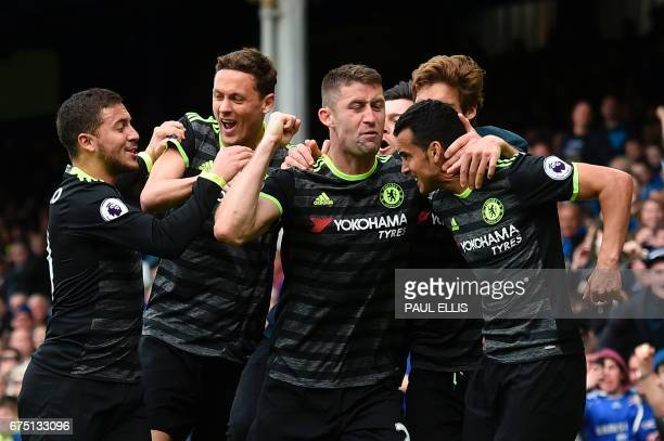 Chelsea's Spanish midfielder Pedro celebrates with teammates after scoring the opening goal during the English Premier League football match between...