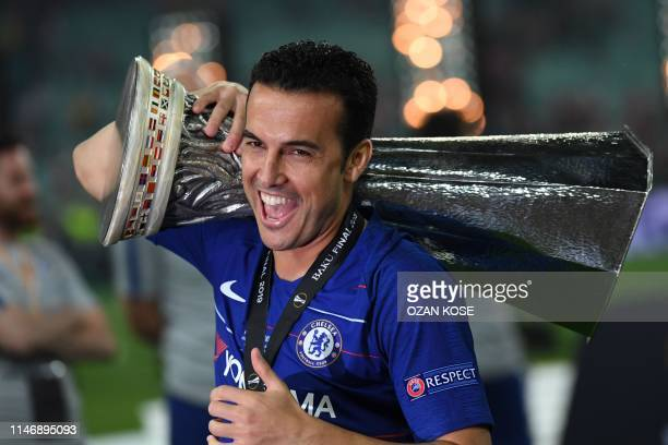 TOPSHOT Chelsea's Spanish midfielder Pedro celebrates with the trophy after winning the UEFA Europa League final football match between Chelsea FC...