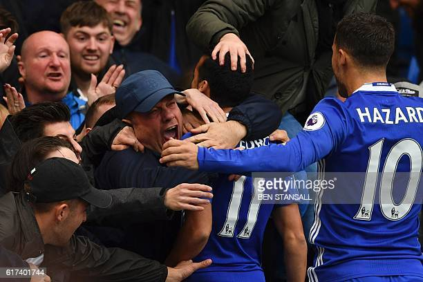 Chelsea's Spanish midfielder Pedro goes into the crowd to celebrate after scoring the opening goal of the English Premier League football match...