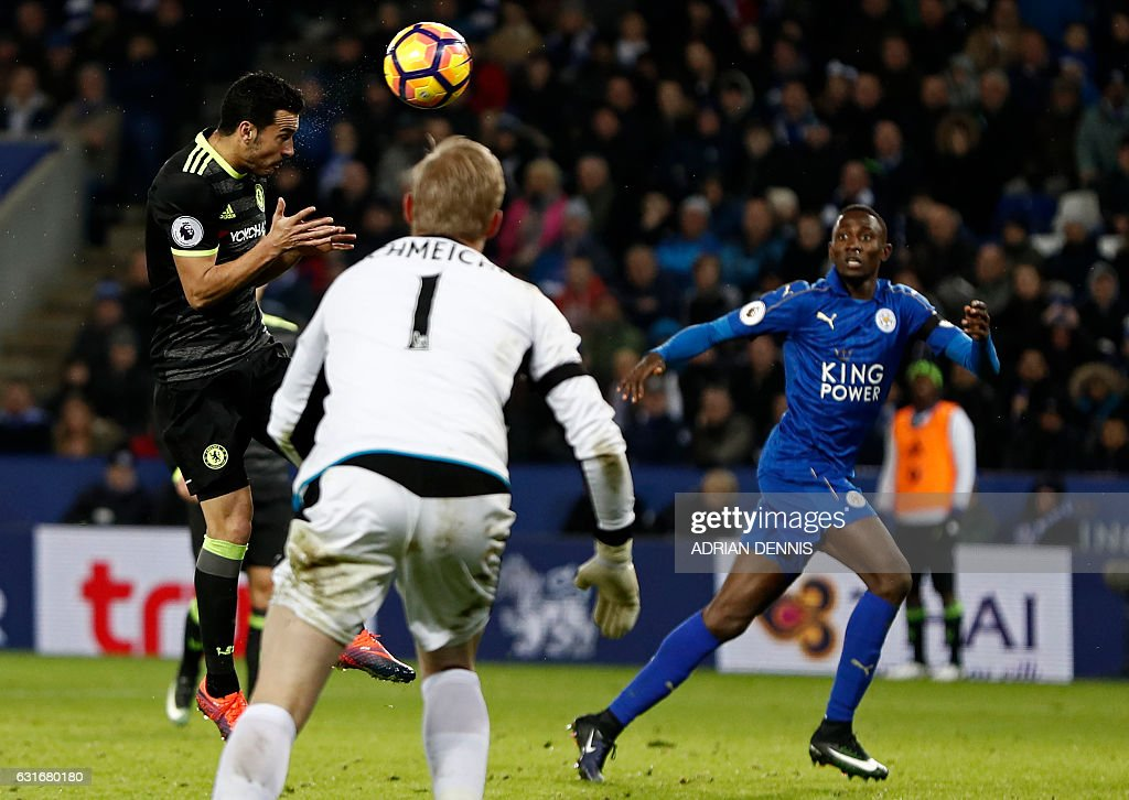 Chelsea's Spanish midfielder Pedro (L) heads home their third goal during the English Premier League football match between Leicester City and Chelsea at King Power Stadium in Leicester, central England on January 14, 2017. / AFP / Adrian DENNIS / RESTRICTED TO EDITORIAL USE. No use with unauthorized audio, video, data, fixture lists, club/league logos or 'live' services. Online in-match use limited to 75 images, no video emulation. No use in betting, games or single club/league/player publications. /