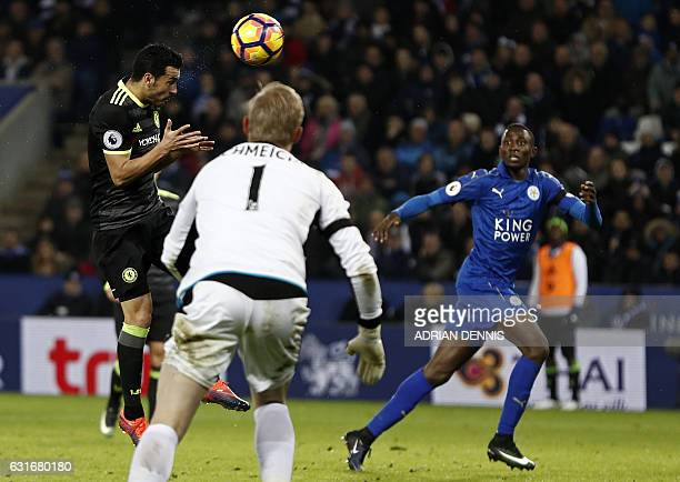 Chelsea's Spanish midfielder Pedro heads home their third goal during the English Premier League football match between Leicester City and Chelsea at...