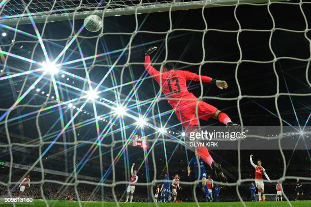 Chelsea's Spanish midfielder Pedro heads the ball to goal but ruled offside during the League Cup semifinal football match between Arsenal and...