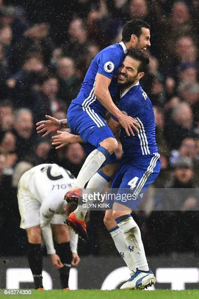 Chelsea's Spanish midfielder Pedro jumps into the arms of Chelsea's Spanish midfielder Cesc Fabregas as he celebrates scoring their second goal...