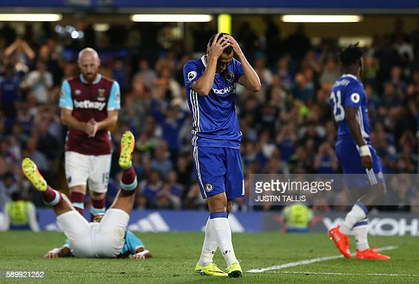 Chelsea's Spanish midfielder Pedro reacts after missing a chance during the English Premier League football match between Chelsea and West Ham United...