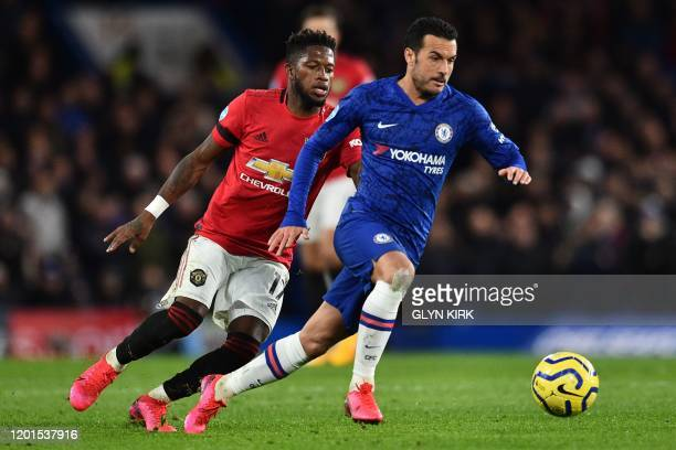 Chelsea's Spanish midfielder Pedro runs away from Manchester United's Brazilian midfielder Fred during the English Premier League football match...