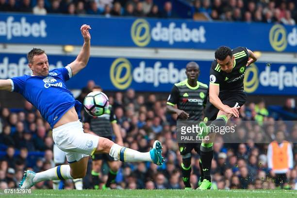 Chelsea's Spanish midfielder Pedro scores the opening goal during the English Premier League football match between Everton and Chelsea at Goodison...
