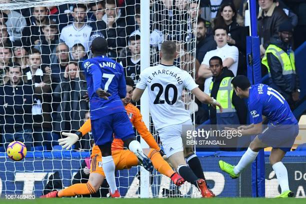 Chelsea's Spanish midfielder Pedro shoots to score the opening goal of the English Premier League football match between Chelsea and Fulham at...