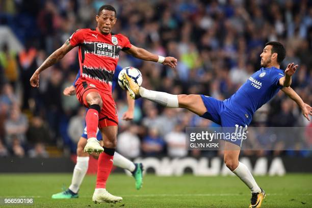 Chelsea's Spanish midfielder Pedro stretches for the ball against Huddersfield Town's Dutch midfielder Rajiv van La Parra during the English Premier...