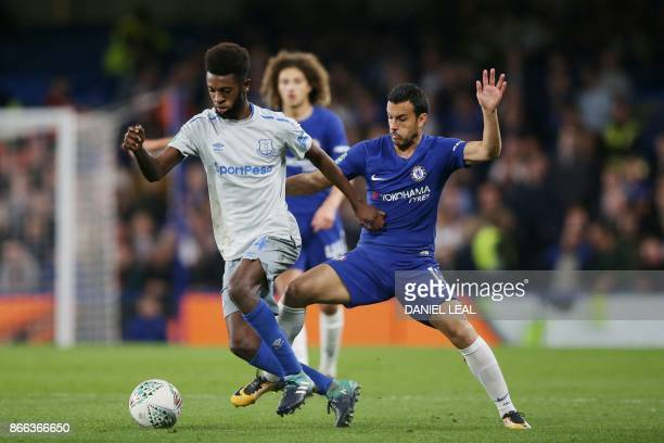 Chelsea's Spanish midfielder Pedro tackles Everton's Beni Baningime during the English League Cup fourth round football match between Chelsea and...