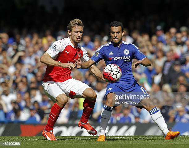 Chelsea's Spanish midfielder Pedro vies with Arsenal's Spanish defender Nacho Monreal during the English Premier League football match between...