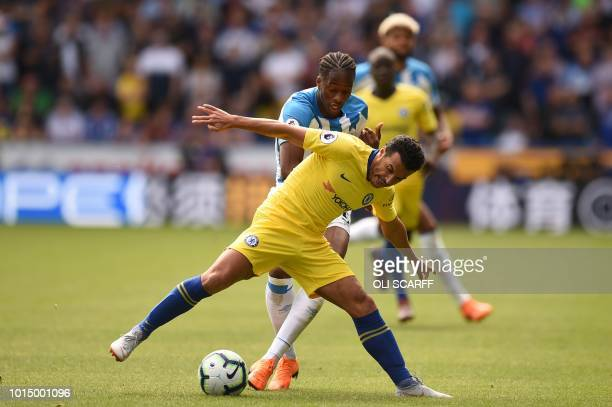 Chelsea's Spanish midfielder Pedro vies with Huddersfield Town's Swissborn Dutch defender Terence Kongolo during the English Premier League football...