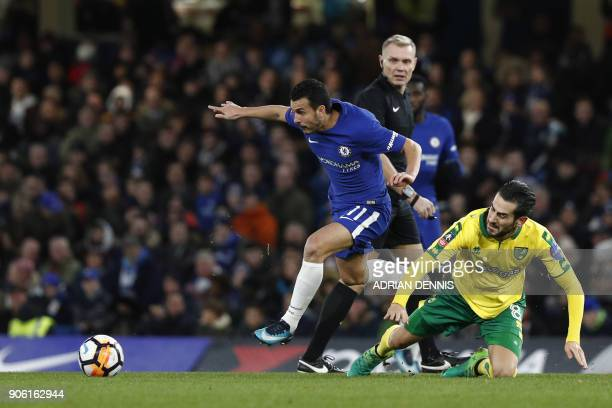 Chelsea's Spanish midfielder Pedro vies with Norwich City's Bosnian midfielder Mario Vrancic during the FA Cup third round replay football match...