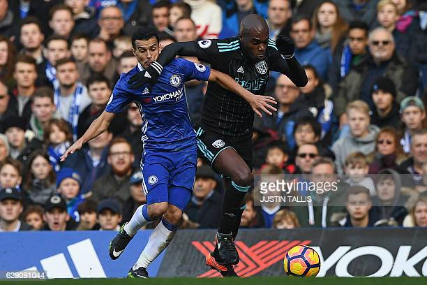 Chelsea's Spanish midfielder Pedro vies with West Bromwich Albion's Frenchborn Cameroonian defender Allan Nyom during the English Premier League...