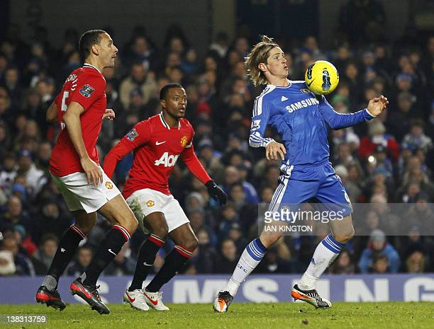 Chelsea's Spanish player Fernando Torres controls the ball as Manchester United's French footballer Patrice Evra and Rio Ferdinand look on during the...