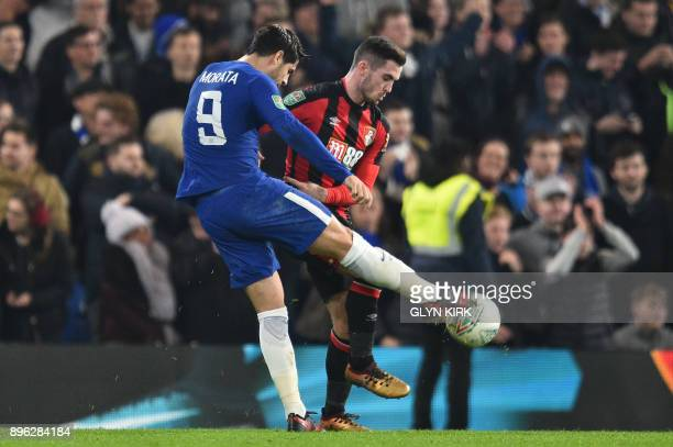 Chelsea's Spanish striker Alvaro Morata and Bournemouth's English midfielder Lewis Cook tussle over the ball during the English League Cup...