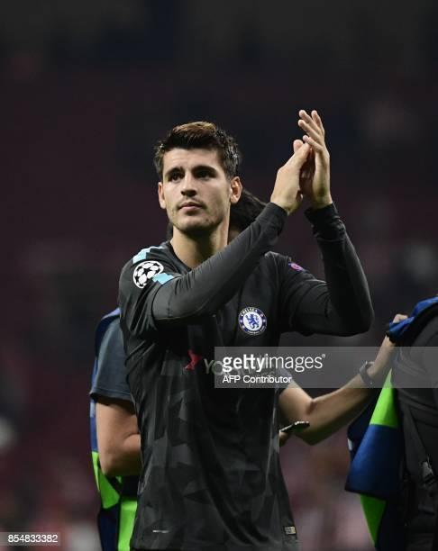 Chelsea's Spanish striker Alvaro Morata applauds at the end of the UEFA Champions League Group C football match Club Atletico de Madrid vs Chelsea FC...