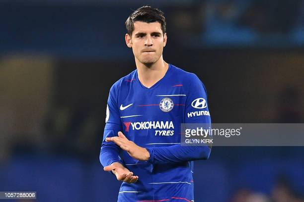 Chelsea's Spanish striker Alvaro Morata applauds supporters on the pitch after the English Premier League football match between Chelsea and Crystal...