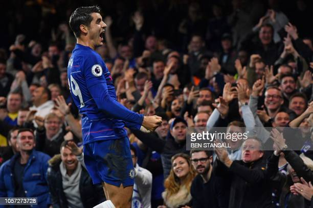 Chelsea's Spanish striker Alvaro Morata celebrates after scoring the opening goal of the English Premier League football match between Chelsea and...