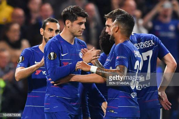 Chelsea's Spanish striker Alvaro Morata celebrates scoring the opening goal during the UEFA Europa League Group L football match between Chelsea and...