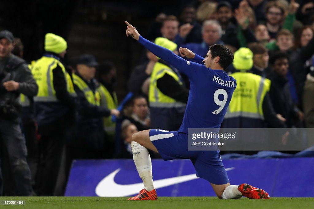 Chelsea's Spanish striker Alvaro Morata celebrates scoring the opening goal during the English Premier League football match between Chelsea and Manchester United at Stamford Bridge in London on November 5, 2017. / AFP PHOTO / Adrian DENNIS / RESTRICTED TO EDITORIAL USE. No use with unauthorized audio, video, data, fixture lists, club/league logos or 'live' services. Online in-match use limited to 75 images, no video emulation. No use in betting, games or single club/league/player publications. /