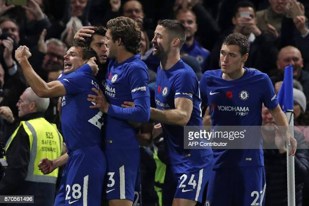 Chelsea's Spanish striker Alvaro Morata celebrates scoring the opening goal with teammates during the English Premier League football match between...